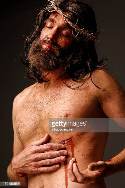 jesus christ touching his pierced side - stab wound stock pictures, royalty-free photos & images
