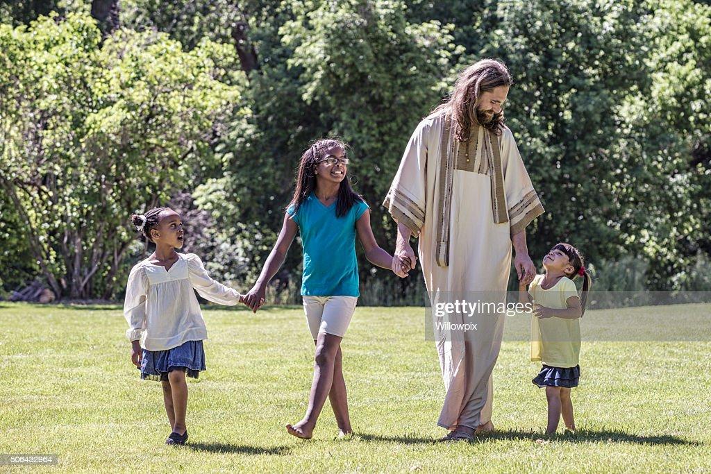 Jesus Christ Walking With Children - Three Young Girls : Stock Photo