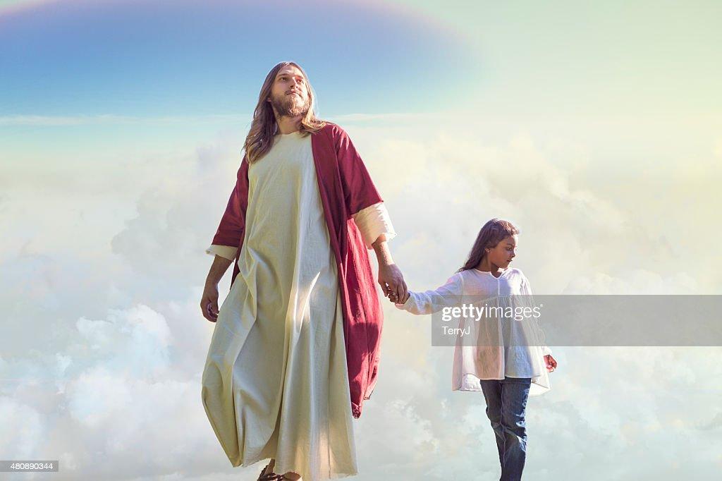 Jesus Christ Walks with a Child Among the Clouds : Stock Photo