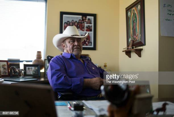 Jesus 'Chuy' Medrano owner of CoCal Landscape works in his office in Denver CO on August 23 2017 The landscaping company relies on temporary migrant...