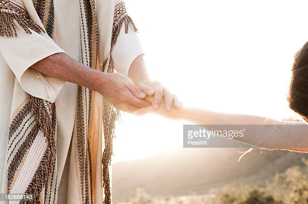 jesus comforting - bounce back stock photos and pictures