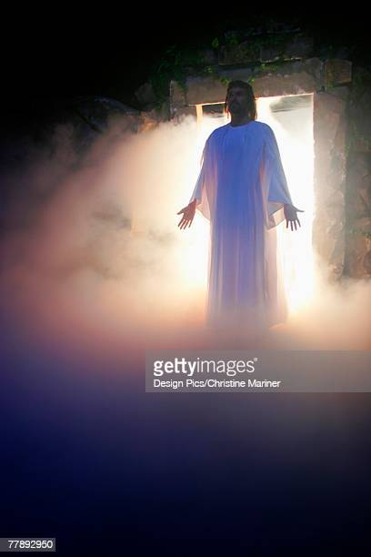 jesus coming out of the tomb - death and resurrection of jesus stock photos and pictures