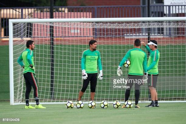 Jesus Corona Miguel Fraga and Moises Munoz goalkeepers of Mexico warm up during the Mexico National Team training session ahead it's match against...