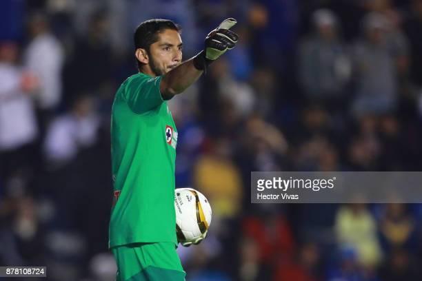 Jesus Corona of Cruz Azul celebrates after blocking a penalty shot during the quarter finals first leg match between Cruz Azul and America as part of...