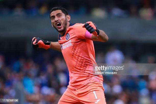 Jesus Corona of Cruz Azul celebrates the third scored goal of Cruz Azul by Roberto Alvarado during the 13th round match between Cruz Azul and America...