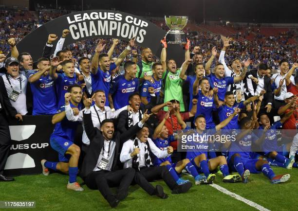 Jesus Corona of Cruz Azul holds up the trophy as he and his teammates celebrate their 2-1 win over Tigres UANL in the Leagues Cup final at Sam Boyd...