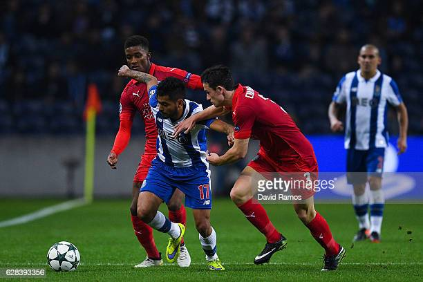 Jesus Corona of FC Porto competes for the ball with Leicester City FC players during the UEFA Champions League match between FC Porto and Leicester...