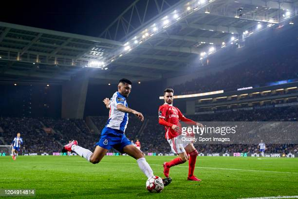 Jesus Corona of FC Porto is challenged by Rafa Silva of SL Benfica during the Liga Nos match between FC Porto and SL Benfica at Estadio do Dragao on...