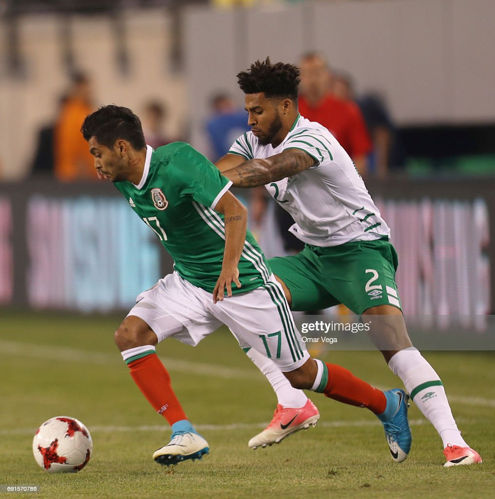 Jesus Corona of Mexico and Cyrus Christie of Ireland compete for the ball during the friendly match between the Republic of Ireland and Mexico at MetLife Stadium on June 01, 2017 in East Rutherford, NJ.
