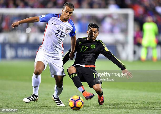 Jesus Corona of Mexico battles for the ball with Timothy Chandler of the United States in the first half during the FIFA 2018 World Cup Qualifier at...