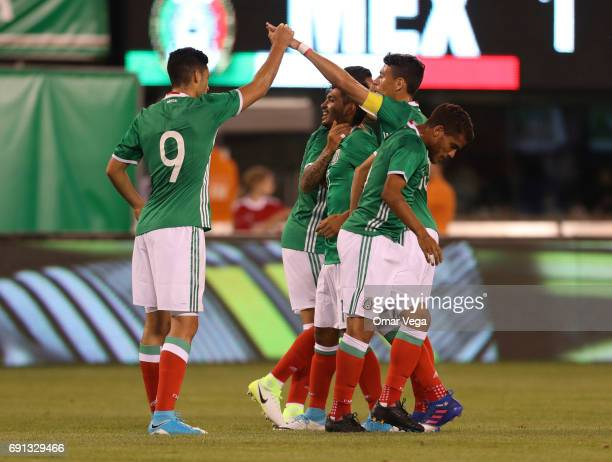 Jesus Corona of Mexico celebrates the opening goal with Raul Jimenez during the friendly match between the Republic of Ireland and Mexico at MetLife...