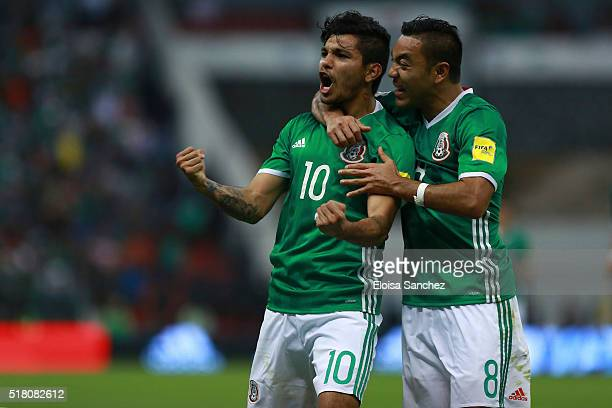 Jesus Corona of Mexico celebrates with teammate Marco Fabian de la Mora after scoring the second goal of his team during the match between Mexico and...