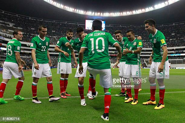 Jesus Corona of Mexico celebrates with teammates after scoring the second goal of his team during the match between Mexico and Canada as part of the...