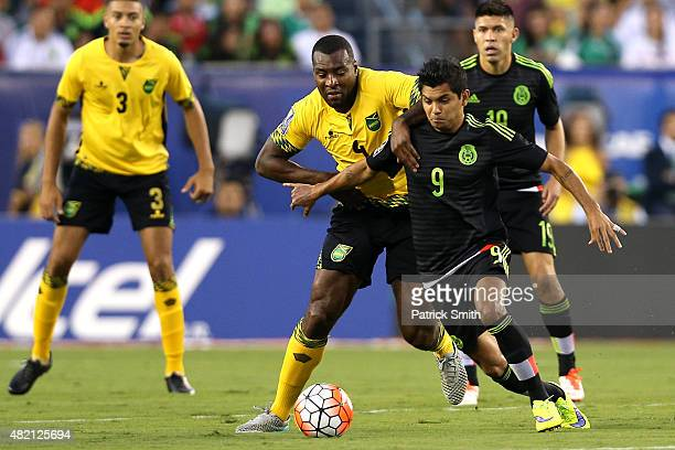 Jesus Corona of Mexico dribbles past Wes Morgan of Jamaica in the first half during the CONCACAF Gold Cup Final at Lincoln Financial Field on July 26...