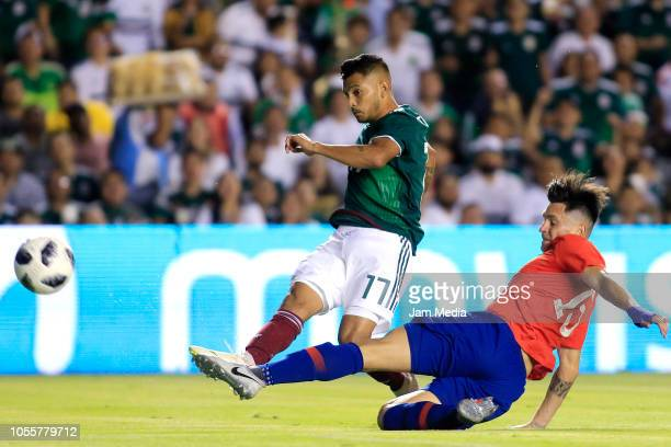 Jesus Corona of Mexico fights for the ball with Alfonso Parot of Chile during the international friendly match between Mexico and Chile at La...
