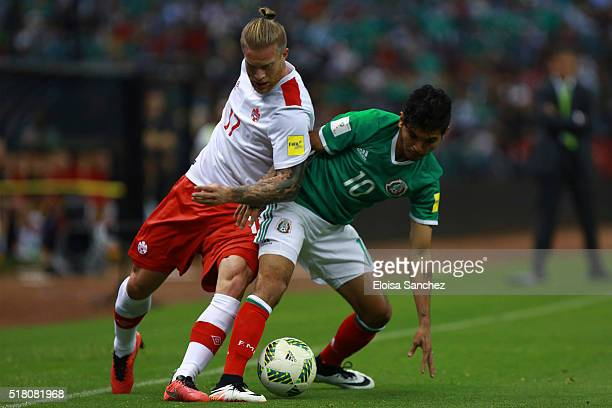 Jesus Corona of Mexico > fights for the ball with Marcel De Jong of Canada during the match between Mexico and Canada as part of the FIFA 2018 World...