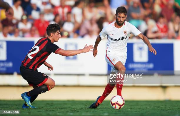 JesUs Crespo 'Pejino' of Sevilla FC duels for the ball with Emerson Hyndman of AFC Bournemouth during Pre Season friendly Match between Sevilla FC...