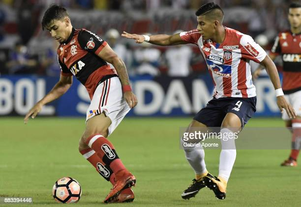 Jesus David Murillo of Junior struggles for the ball with Lucas Paqueta of Flamengo during a second leg match between Junior and Flamengo as part of...