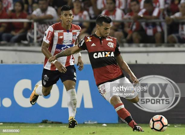 Jesus David Murillo of Junior struggles for the ball with Miguel Trauco of Flamengo during a second leg match between Junior and Flamengo as part of...