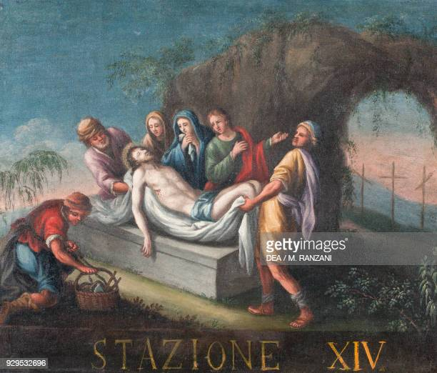 Jesus' disciples place his body in the tomb 14th station of the Stations of the Cross painting Lombardy Italy 18th century