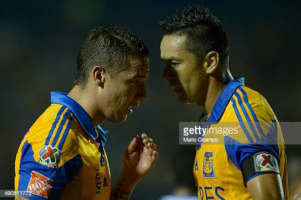 Jesus Dueñas and Juninho of Tigres talk during the 11th round match between Tigres UANL and Puebla as part of the Apertura 2015 Liga MX at...