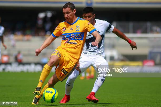 Jesus Dueñas of Tigres and Jesus Gallardo of Pumas fights for the ball during the 5th round match between Pumas UNAM and Tigres UANL as part of the...
