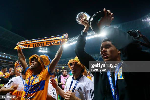 Jesus Dueñas of Tigres and Juninho of Tigres lift the trophy to celebrate after winning the second leg of the Torneo Apertura 2017 Liga MX final...