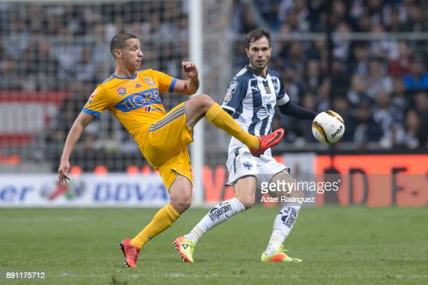 Jesus Dueñas of Tigres fights for the ball with Jose Maria Basanta of Monterrey during the second leg of the Torneo Apertura 2017 Liga MX final...