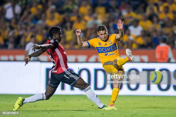 Jesus Dueñas of Tigres fights for the ball with Serge Njoh of Atlas during the 8th round match between Tigres UANL and Atlas as part of the Torneo...