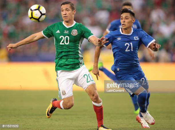 Jesus Duenas of Mexico competes for the ball with Bryan Tamacas of El Salvador during a Group C match between Mexico and El Salvador as part of Gold...