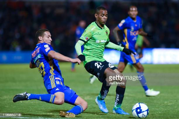Jesus Duenas of Tigres and Diego Rolan of Juarez fight for the ball during the 19th round match between FC Juarez and Tigres UANL as part of the...