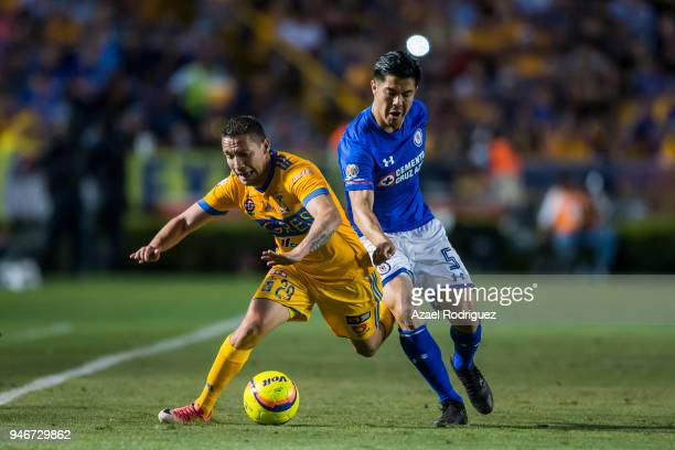 Jesus Duenas of Tigres fights for the ball with Francisco Silva of Cruz Azul during the 15th round match between Tigres UANL and Cruz Azul as part of...
