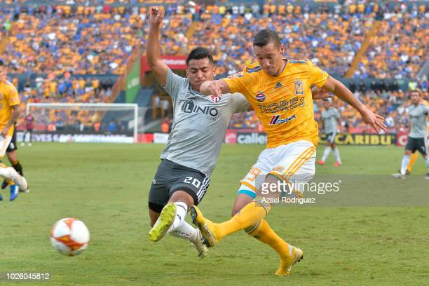 Jesus Duenas of Tigres fights for the ball with Ian Torres of Atlas during the 6th round match between Tigres UANL and Veracruz as part of the Torneo...