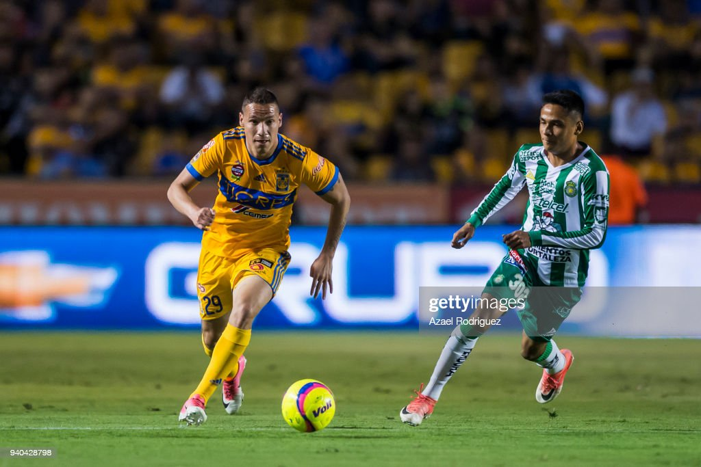 f8c74637b1a Jesus Duenas of Tigres fights for the ball with Jorge Diaz of Leon ...