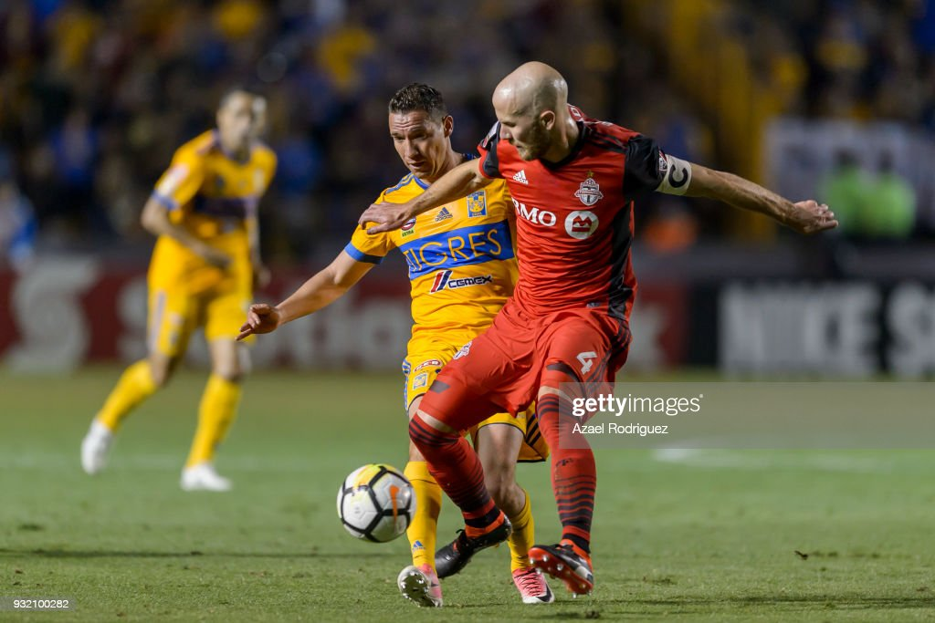 Jesus Duenas of Tigres fights for the ball with Michael Bradley of Toronto during the quarterfinals second leg match between Tigres UANL and Toronto FC as part of the CONCACAF Champions League 2018 at Universitario Stadium on March 13, 2018 in Monterrey, Mexico.