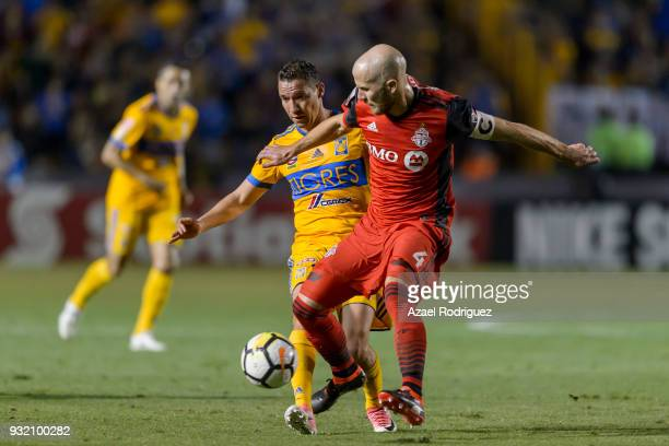 Jesus Duenas of Tigres fights for the ball with Michael Bradley of Toronto during the quarterfinals second leg match between Tigres UANL and Toronto...