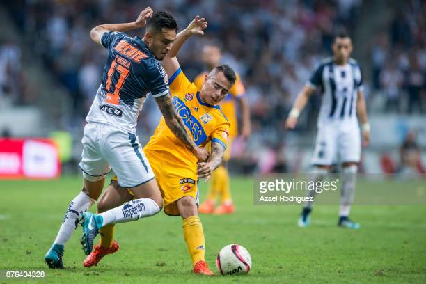 Jesus Eduardo Zavala of Monterrey fights for the ball with Lucas Zelarayan of Tigres during the 17th round match between Monterrey and Tigres UANL as...