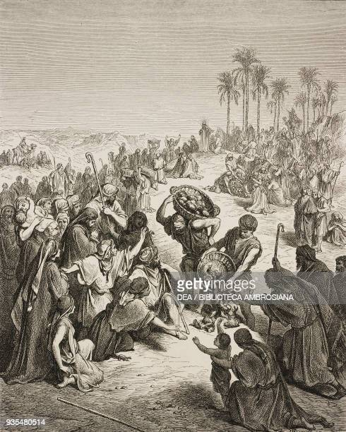 Jesus feeds the multitude with five loaves and two fishes engraving by Gustave Dore from The Holy Scriptures containing the Old and New Testaments...