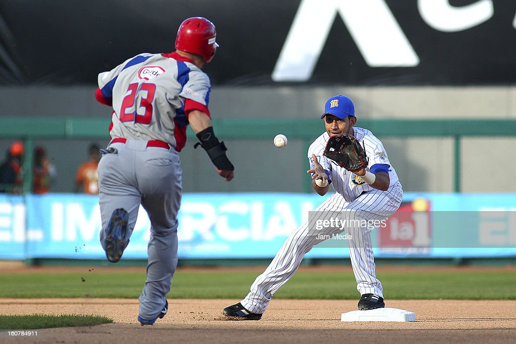 Jesus Feliciano of Puerto Rico and Osuna Renny of Venezuela in action during a match between Puerto Rico and Venezuela as part of the Caribbean Series 2013 at Sonora Stadium on February 05, 2013 in Hermosillo, Mexico.