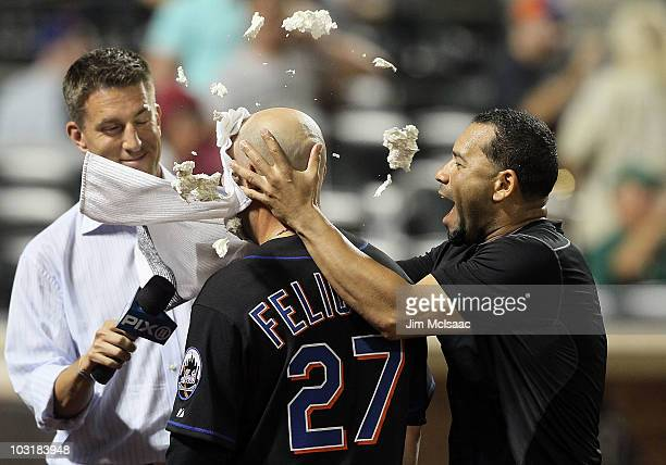 Jesus Feliciano of the New York Mets gets a shaving cream pie in the face in celebration from teammate Pedro Feliciano after scoring the winning run...