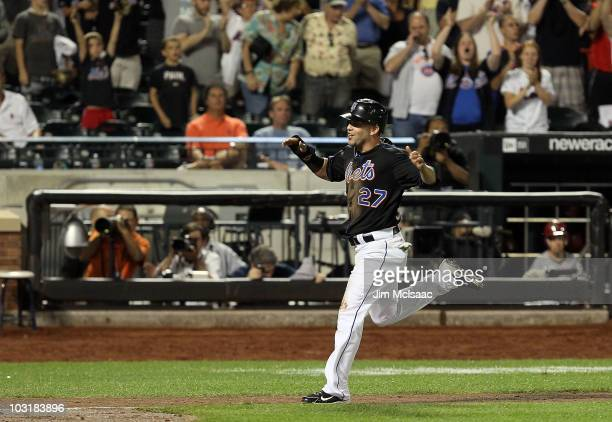 Jesus Feliciano of the New York Mets scores the winning run in the ninth inning against the Arizona Diamondbacks on a sacrifice fly from teammate...