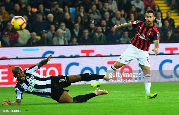 Jesus Fernandez Suso of AC Milan competes for the ball with Gaetano De Souza Santos Samir of Udinese Calcio during the Serie A match between Udinese...