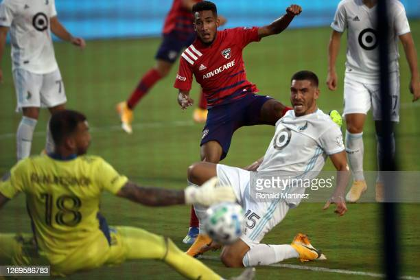 Jesus Ferreira of FC Dallas scores a goal against Greg Ranjitsingh of Minnesota United in the first half at Toyota Stadium on August 29 2020 in...