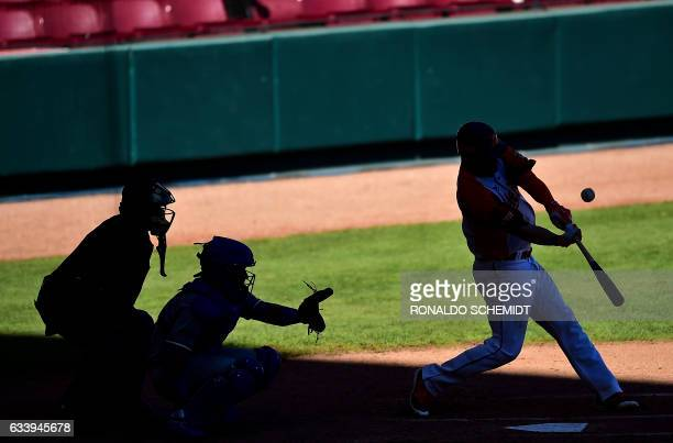 Jesus Flores of Aguilas del Zulia of Venezuela bats against Tigres del Licey of the Dominican Republic during the Caribbean Baseball Series at the...