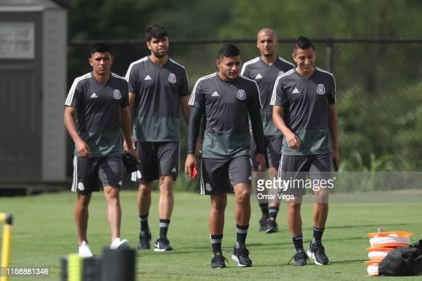 Jesus Gallardo Nestor Araujo Alexis Vega Luis Rodriguez and Roberto Alvarado of Mexico warms up during Mexico national team training session as part...