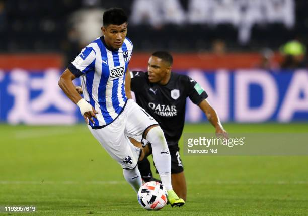 Jesus Gallardo of CF Monterrey runs with the ball from Pedro Miguel of AlSadd Sports Club during the FIFA Club World Cup 2nd round match between...