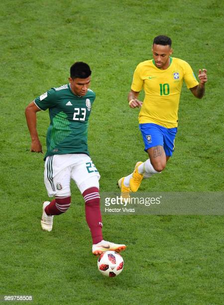 Jesus Gallardo of Mexico challenge for the ball with Neymar Jr of Brazil during the 2018 FIFA World Cup Russia Round of 16 match between Brazil and...