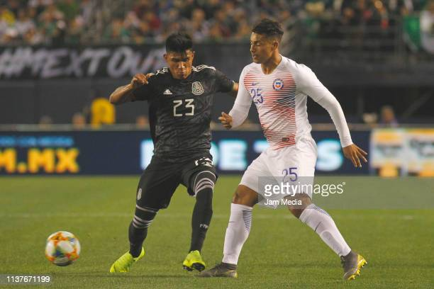 Jesus Gallardo of Mexico fights for the ball with Ivan Morales of Chile during an international friendly match between Chile and Mexico at Qualcomm...