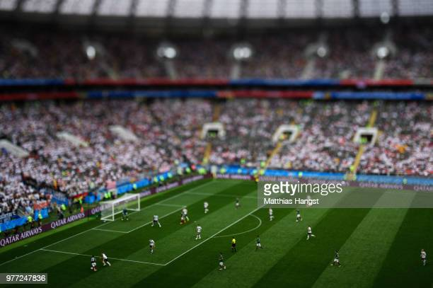 Jesus Gallardo of Mexico is challenged by Joshua Kimmich of Germany during the 2018 FIFA World Cup Russia group F match between Germany and Mexico at...