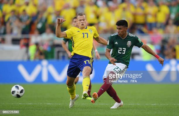 Jesus Gallardo of Mexico tackles Viktor Claesson of Sweden during the 2018 FIFA World Cup Russia group F match between Mexico and Sweden at...